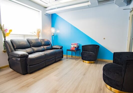 Crestmonts entertainment room showing relaxation sofas and decorations with blue and white background
